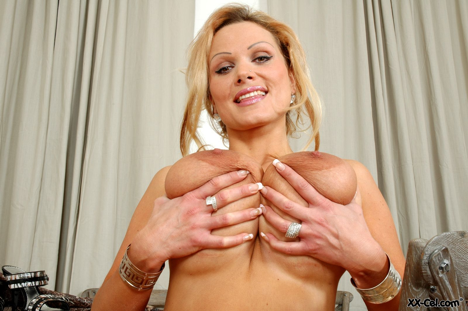 Hot milf lets the wind blow her skirt up 2